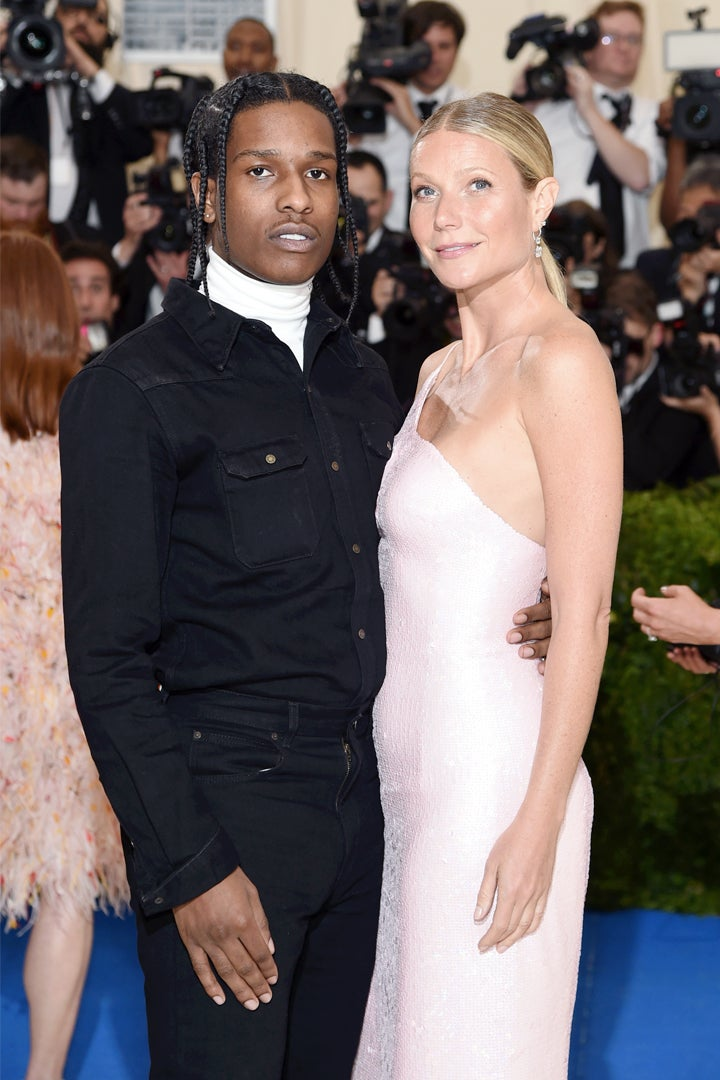 A$AP Rocky, wearing a CALVIN KLEIN 205W39NYC turtleneck, black denim shirt, and matching jean, with Gwyneth Paltrow, in a Calvin Klein By Appointment pale pink one-shoulder sequined cocktail dress.