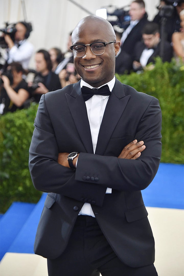 Barry Jenkins wears a CALVIN KLEIN 205W39NYC black wool double-breasted pique lapel tuxedo and white poplin dress shirt.
