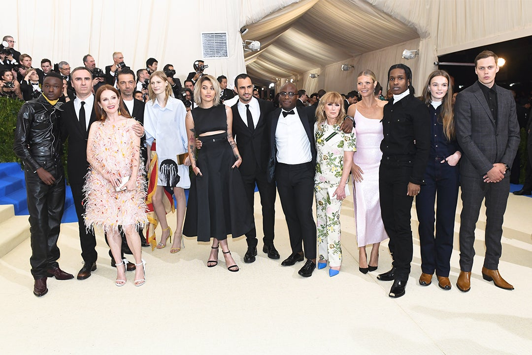 Raf Simons and guests of Calvin Klein on the red carpet at the 2017 Met Gala.