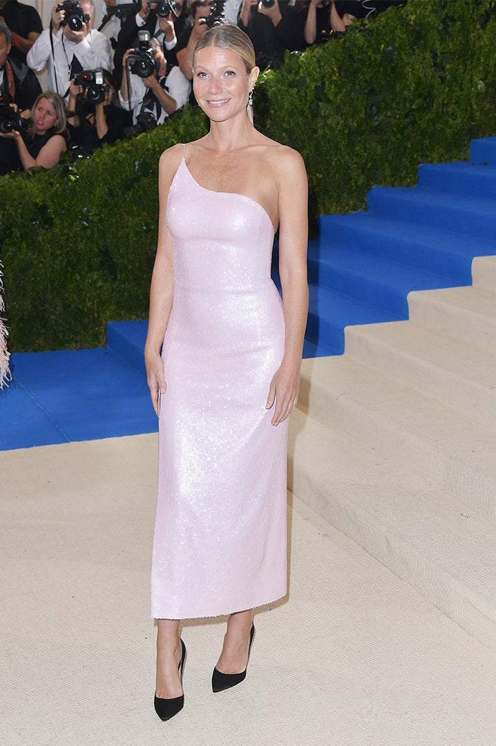 Gwyneth Paltrow wears a Calvin Klein By Appointment pale pink one-shoulder sequin cocktail dress.